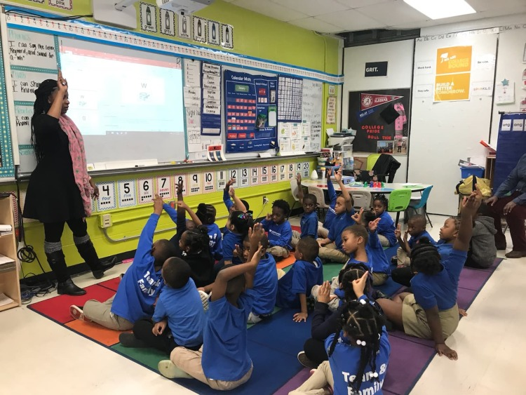 At KIPP Memphis Preparatory Elementary, teacher Nova Moss leads kindergarten students through foundational words and sounds. They use their fingers to spell the words in the air. (Cole Bradley)